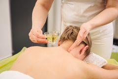 Woman having neck and shoulder massage in spa center royalty free stock photos