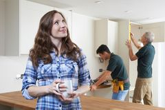 Woman Having New Kitchen Fitted Drinking Cup Of Coffee royalty free stock image