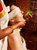 Woman having ayurveda spa treatment. Stock Images