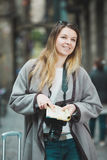 Woman having pamphlet and looking for her route. Attractive girl having pamphlet and looking for her route in the city royalty free stock image