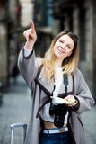 Woman having pamphlet and looking for her route. Positive girl having pamphlet and looking for her route in the city royalty free stock photography