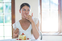 Woman having a pastry in restaurant Stock Images