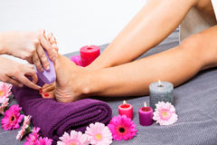 Woman having a pedicure treatment at a spa stock images