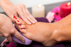 Woman having a pedicure treatment at a spa royalty free stock photo