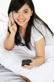 Woman having a phone call while texting message Stock Images
