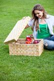 Woman having a picnic Stock Images