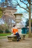 Woman having a picnic near the Eiffel tower Stock Photo