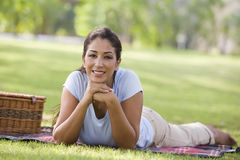 Woman having picnic in park Stock Images