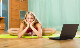 Woman having pilates with notebook Royalty Free Stock Photos