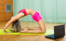 Woman having pilates with notebook Royalty Free Stock Photography