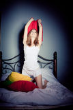 Woman having pillow fight Royalty Free Stock Photography