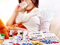 Woman having pills and tablets. Stock Images