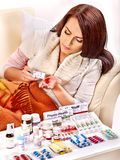 Woman having pills and tablets. Stock Image