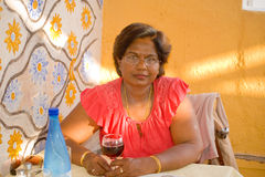 Woman having a pre-dinner drink. royalty free stock photography