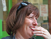 Woman having a private chuckle. Photo of a woman having a private chuckle to herself after spotting something amusing Stock Photos
