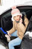 Woman having problem with car in snow Royalty Free Stock Photo