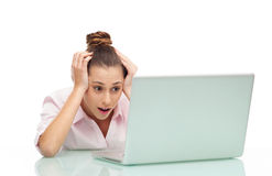 Woman having a problem with her laptop Stock Image