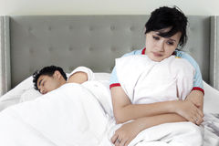 Woman having problem with husband in bed Royalty Free Stock Photo