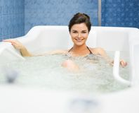 Woman having procedure. In a  bathtub Royalty Free Stock Image