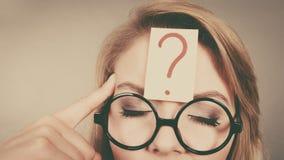 Woman having question mark on head thinking Royalty Free Stock Photos
