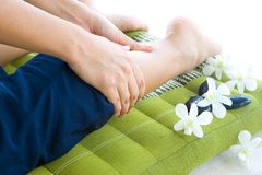 Woman having reflexology by therapist Stock Photos