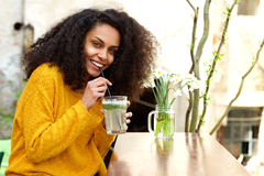 Woman having refreshing drink at outdoor cafe Stock Image