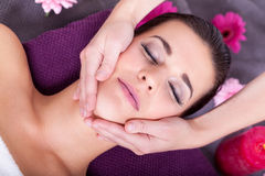 Woman having a relaxing facial massage Stock Photo