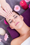 Woman having a relaxing facial massage Royalty Free Stock Photo