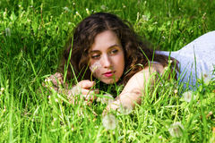 Woman having rest on meadow Royalty Free Stock Photo
