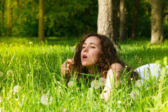 Woman having rest on meadow stock photo