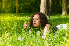 Woman having rest on meadow stock photos