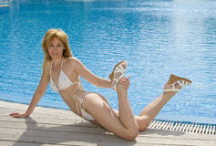 Woman  having a rest at pool Stock Photos