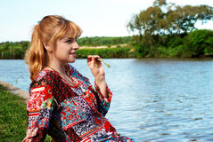 Woman having a rest on protect rivers Stock Photos