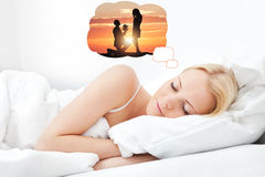 Woman Having Romantic Dreams While Sleeping. Young Beautiful Woman Dreaming Of Having Romantic Time Spending With Her Boyfriend While Sleeping Royalty Free Stock Images