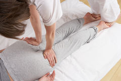 Woman having Shiatsu massage Stock Photo