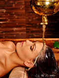 Woman having Shirodhara pouring oil on head in India spa . Stock Images