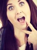 Woman having shocked amazed face expression Royalty Free Stock Images