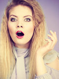 Woman having shocked amazed face expression. Attractive woman with dark brown hair having shocked amazed face expression with wide open mouth gesturing hands Royalty Free Stock Photos