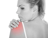 Woman having shoulder pain Stock Photography