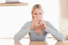 Woman having a sip of water Royalty Free Stock Images