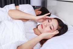 Woman having sleepless on bed and having migraine,stress, insomnia, hangover in bedroom. Woman having sleepless on bed and having migraine,stress, insomnia royalty free stock images