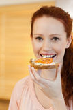 Woman having a slice of bread Royalty Free Stock Photography