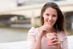 Woman having a smoothie Royalty Free Stock Images