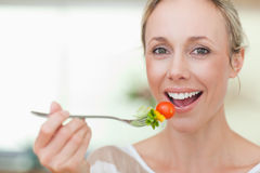 Woman having some salad Stock Photography