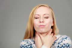 Woman having sore throat feeling pain. Feeling bad, disease, illness problem concept. Woman having sore throat, thouching her neck feeling pain royalty free stock photography