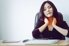 Woman having sore throat and neck pain in office. Woman is having sore throat and neck pain in office Royalty Free Stock Photos