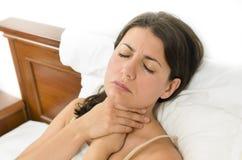 Woman having sore throat royalty free stock photo
