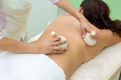 Woman having spa bags massage in wellness salon. Closeup royalty free stock photography