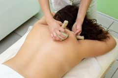 Woman having spa bags massage in wellness salon. Closeup stock photos