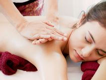 Woman having spa body massage treatment in the spa salon,Massage. And body care Stock Image